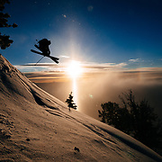 Forrest Jillson grabs some air at sunrise in the Teton backcountry.