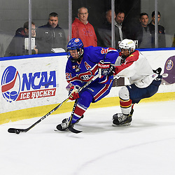 BUFFALO, NY - SEP 20,  2017: Ontario Junior Hockey League Governors Showcase game between the Toronto Jr. Canadiens and Wellington Dukes, Pierce Nelson #1 of the Wellington Dukes tries to keep the puck from Jason Pineo #21 of the Toronto Jr. Canadiens during the third period.<br /> (Photo by Andy Corneau / OJHL Images)