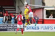Ebbsfleet united defender Dave Winfield (5) beats AFC Wimbledon striker Cody McDonald (10) to a header during the Pre-Season Friendly match between Ebbsfleet and AFC Wimbledon at Stonebridge Road, Ebsfleet, United Kingdom on 29 July 2017. Photo by Matthew Redman.
