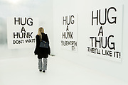 New York, NY - 5 May 2017. The opening day of the Frieze Art Fair, showcasing modern and contemporary art presented by galleries from around the world, on Randall's Island in New York City. A series of hug-themed paintings by artist Karl Holmqvist in the gallery of Gavin Brown's Enterprise.