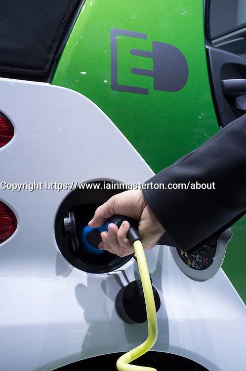 Electric SMART car being recharged at Paris Motor Show 2012