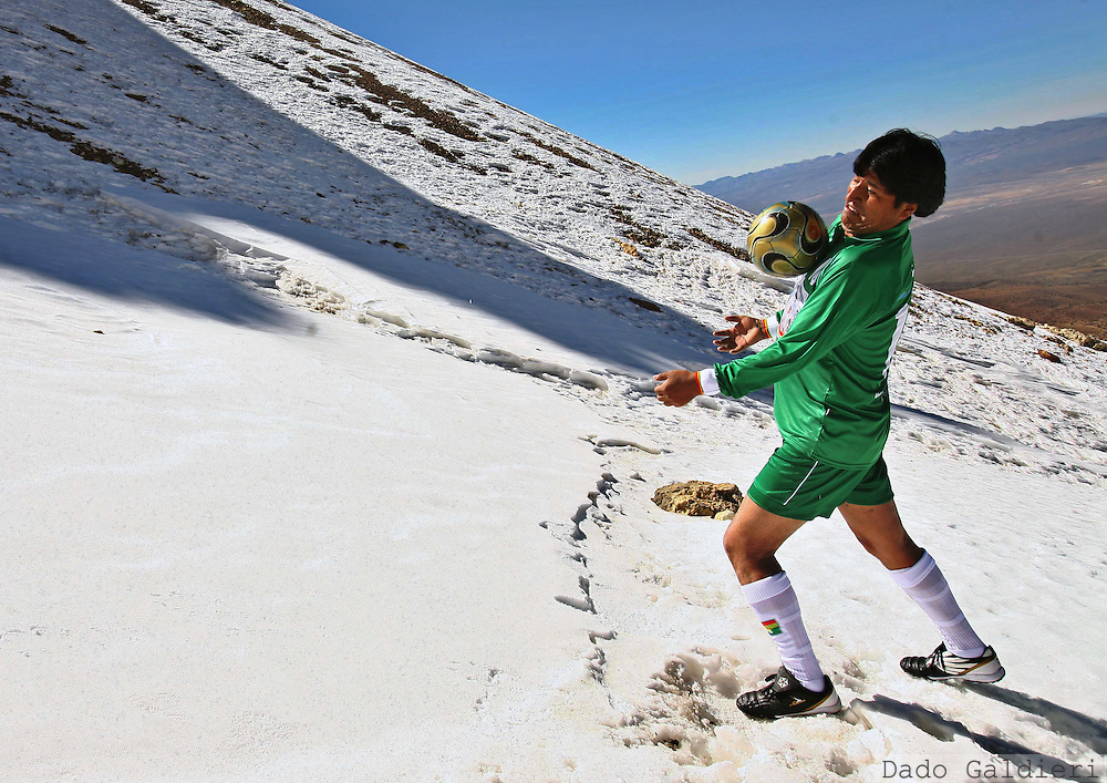 Bolivia's president Evo Morales controls the ball during a soccer match against alpine guides at 6000 meters, 19,700 feet,  above seal level, at the snowcapped Sajama dormant volcano  in western Bolivia, Tuesday, June 12, 2007.  President Evo Morales scored the winning goal in a slippery soccer match on the icy slopes of Bolivia's highest Andean peak, gleefully thumbing his nose at a recent FIFA ban on international games at high altitude.
