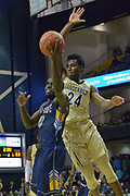 Kent State Golden Flashes guard Jalen Avery (0) shoots  against Vanderbilt Commodores forward Aaron Nesmith (24) during the second half of an NCAA basketball game in Nashville, Tenn., Friday, Nov. 23, 2018. Kent State won 77-75. (Jim Brown/Image of Sport)
