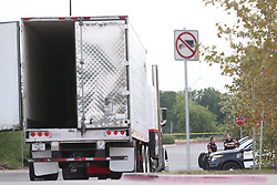 July 23, 2017 - San Antonio, Tx, United States - Law enforcement is at the scene where people were discovered inside a tractor trailer in a Walmart parking lot at IH35 South and Palo Alto Road. Reports say that 8 were dead be several were in critical condition. (Credit Image: © San Antonio Express-News via ZUMA Wire)