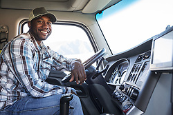 April 10, 2018 - Black man truck driver in the cab of his commercial truck. (Credit Image: © Mint Images via ZUMA Wire)