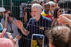 © Licensed to London News Pictures. 30/06/2018. London, UK. Labour Party Leader JEREMY CORBYN speaks with protestors on Whitehall after a march in support of the National Health Service on the 70th anniversary of its founding. Thousands are taking part and will here speeches by Jeremy Corbyn and others in Whitehall. Photo credit: Rob Pinney/LNP