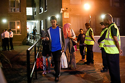 © Licensed to London News Pictures. 23/06/2017. London, UK. Residents being evacuated from the Taplow block of the Chalcots Estate in Camden after it failed a fire inspection because of combustable cladding. Prime Minister Theresa May has told Parliament that up to 600 high rise tower blocks may have similar cladding to that found in Grenfell Tower, which went on fire last week, in which as many as 79 residents are thought to have perished Photo credit: Ben Cawthra/LNP