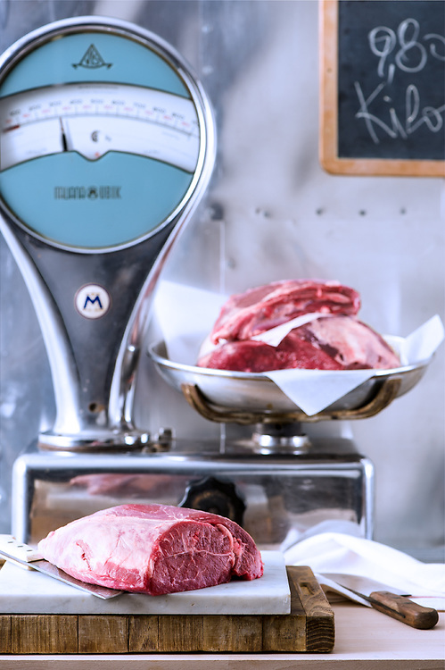 raw meat on a old style butcher's scale