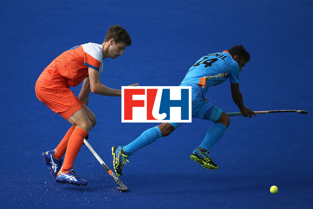 RIO DE JANEIRO, BRAZIL - AUGUST 11:  Sunil Sowmarpet #24 of India runs past Sander Baart #13 of Netherlands during a Men's Preliminary Pool B match on Day 6 of the Rio 2016 Olympics at the Olympic Hockey Centre on August 11, 2016 in Rio de Janeiro, Brazil.  (Photo by Sean M. Haffey/Getty Images)