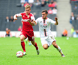Bristol City's Joe Bryan jostles for the ball with Milton Keynes Dons' George Baldock  - Photo mandatory by-line: Dougie Allward/JMP - Tel: Mobile: 07966 386802 24/08/2013 - SPORT - FOOTBALL - Stadium MK - Milton Keynes -  Milton Keynes Dons V Bristol City - Sky Bet League One