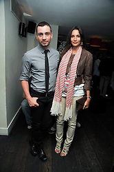 ASTRID MUNOZ and JONATHAN KELSEY at a party and screening of Jonathan Kelsey & Sara Dunlop's short film 'High' held at Soho House, Old Compton Street, London on 15th July 2009.