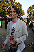 JEREMY DELLER, 2014 Serpentine's summer party sponsored by Brioni.with a pavilion designed this year by Chilean architect Smiljan Radic  Kensington Gdns. London. 1July 2014