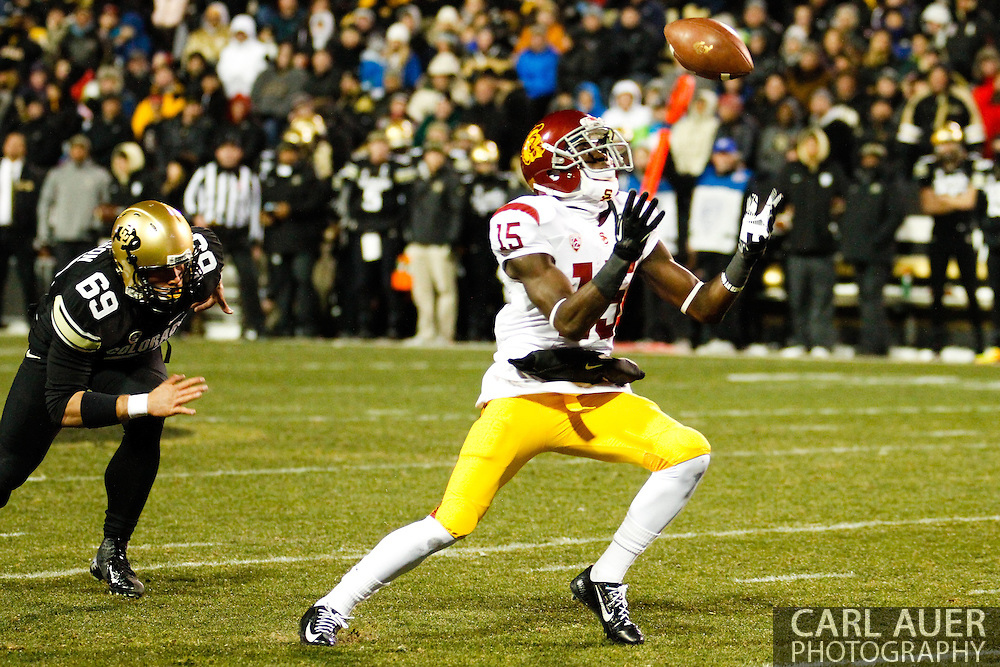 November 23rd, 2013:  USC Trojans sophomore wide receiver Nelson Agholor (15) juggles the ball after calling for a fair catch on a Colorado punt in second quarter action of the NCAA Football game between the University of Southern California Trojans and the University of Colorado Buffaloes at Folsom Field in Boulder, Colorado