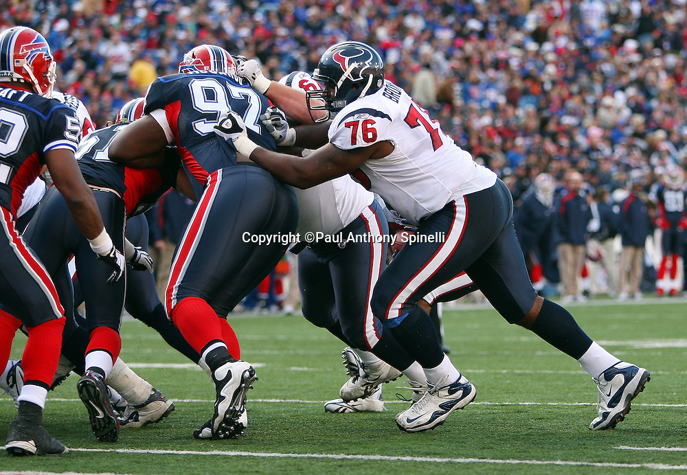 Houston Texans offensive tackle Duane Brown (76) blocks Buffalo Bills defensive tackle John McCargo (97) during the NFL football game against the Buffalo Bills, November 1, 2009 in Orchard Park, New York. The Texans won the game 31-10. (©Paul Anthony Spinelli)
