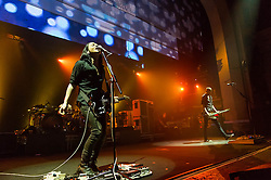© Licensed to London News Pictures. 16/12/2013. London, UK.   Placebo performing live at Brixton Academy. In this picture - Brian Molko (left), Stefan Olsdal (right).  .Placebo are an English alternative rock band, formed in London in 1994, consisting of members Brian Molko (lead vocals/guitars), Stefan Olsdal (vocals/bass), Steve Forrest (drums/vocals).  The band is touring to support its seventh studio album 'Loud Like Love'. Photo credit : Richard Isaac/LNP