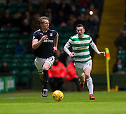 4th April 2018, Celtic Park, Glasgow, Scotland; Scottish Premier League football, Celtic versus Dundee; Mark O'Hara of Dundee goes past Callum McGregor of Celtic
