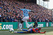 Manchester City defender Benjamin Mendy (22) jumps over Crystal Palace defender Aaron Wan-Bissaka (29) during the Premier League match between Crystal Palace and Manchester City at Selhurst Park, London, England on 14 April 2019.