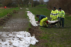 © Licensed to London News Pictures. 07/01/2014, Edenbridge, UK. Environment Agency workers builts a flood defence with sand bags by Eden River at Edenbridge in Kent , Tuesday, Jan. 7, 2014. Photo credit : Sang Tan/LNP