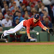 BOSTON, MA - SEPTEMBER 20:  Will Middlebrooks #16 of the Boston Red Sox makes a diving grab against the Toronto Blue Jays on September 20, 2013 at Fenway Park in Boston, Massachusetts.  (Photo by Michael Ivins/Boston Red Sox)