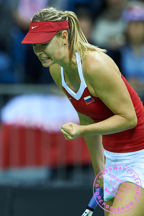 Maria Sharapova from Russia reacts after winning point during Second Day of the Fed Cup / World Group 1st round tennis match between Poland and Russia at Tauron Krakow Arena on February 8, 2015 in Cracow, Poland.<br /> <br /> Poland, Cracow, February 8, 2015<br /> <br /> Picture also available in RAW (NEF) or TIFF format on special request.<br /> <br /> For editorial use only. Any commercial or promotional use requires permission.<br /> <br /> Adam Nurkiewicz declares that he has no rights to the image of people at the photographs of his authorship.<br /> <br /> Mandatory credit:<br /> Photo by &copy; Adam Nurkiewicz / Mediasport