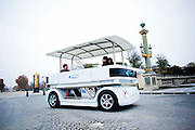 """World's first commercial driverless car goes on sale - but it only reaches a top speed of 12mph <br /> <br /> The race to get the first self-driving cars on the road has seen the likes of Tesla and Google battle it out to develop their most advanced vehicles.<br /> But a relatively small French company has now beaten the motor giants to it by unveiling the world's first commercially available driverless car.<br /> The forty-strong company, Induct, announced this week that its zero-emissions vehicle is now available in the U.S.<br /> <br /> It might not have the sleek lines of a Tesla, or the stylish interior of a BMW, but the group's Navia shuttle could help pave the way for more advanced autonomous vehicles.<br /> <br /> Launched at the International CES show in Las Vegas, it can carry up to eight passengers and costs around $250,000 (£152,000).<br /> The electric vehicle, which doesn't go faster than 12.5 mph, uses on-board lasers to detect obstacles in its path, rather than GPS.<br /> <br /> The company claims the car is different because it is 'intelligent, self-sufficient and environmentally friendly'.<br /> For instance, users can summon Navia from their smartphones or call it up from their desktop. Once on board, passengers use a touchscreen to select their destination.<br /> It also doesn't require special infrastructure such as rails so it can work on any kind of site.<br /> Rather than for regular road use, the car is expected to be used in areas such as airports, university campuses, stadiums and arenas.<br /> 'Imagine a city without noisy, polluting buses, replaced by environmentally-friendly, robotic shuttle buses that can be summoned by your mobile phone,' said Pierre Lefevre, chief executive of Induct.<br /> 'Navia is completely self-driving, 100 per cent electric, emission-free, safe and simple to use. It is the ideal solution for taking pedestrians that """"last mile""""'.<br /> The car is currently being used in beta version at the Ecole Polytechnique Fé"""