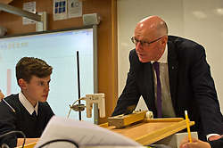 Pictured: John Swinney joined in a third year physics class led by head of science David Dalglish<br /> <br /> Deputy First Minister and Education Secretary John Swinney visited St Augiustine's RC High School in Edinburgh to speak to young people about attainment and leaving schools with the suite of statistics published today. St Augustine's RC High School<br /> <br /> <br /> Ger Harley   EEm 19 June 2018