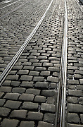 Tram tracks in cobbled street  in Korenmarkt, Ghent, Belgium