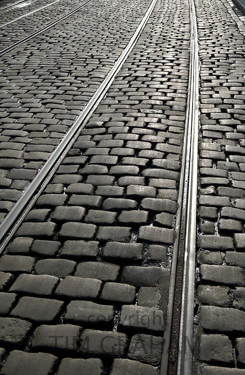 Tram tracks in cobbled street  in Korenmarkt, Ghent, Belgium