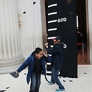 Activist theatre group BP or not BP drop thousands of paper oil drops in the British Museum in protest of BP's sponsorship of the museum. The action marked the ending of the Bp sponsored Scythian exhibition.