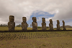 Chile, Easter Island: Statues or moai on a platform or ahu at Ahu Akivi, an inland array of moai, unusual because most moai face inland from the edge of the sea..Photo #: ch300-33633..Photo copyright Lee Foster www.fostertravel.com lee@fostertravel.com 510-549-2202