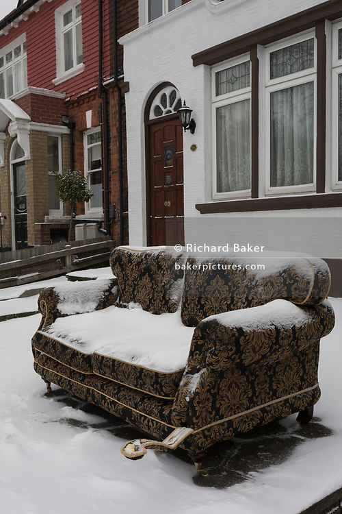 An unwanted sofa sits in the front of a house in a residential street during the bad weather covering every part of the UK and known as the 'Beast from the East' because Siberian winds and very low temperatures have blown across western Europe from Russia, on 1st March 2018, in Lambeth, London, England.