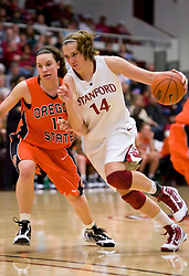 February 20, 2010; Stanford, CA, USA;  Stanford Cardinal forward Kayla Pedersen (14) dribbles past Oregon St. Beavers guard Talisa Rhea (11) during the second half at Maples Pavilion.  Stanford defeated Oregon State 82-48.