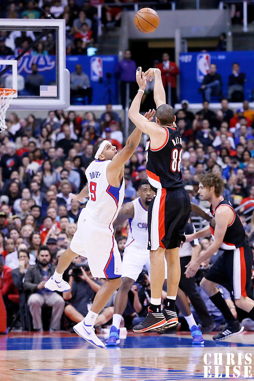 12 February 2014: Portland Trail Blazers small forward Nicolas Batum (88) takes a jumpshot over Los Angeles Clippers small forward Jared Dudley (9) during the Los Angeles Clippers 122-117 victory over the Portland Trail Blazers at the Staples Center, Los Angeles, California, USA.