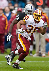 December 13, 2009; Oakland, CA, USA;  Washington Redskins running back Quinton Ganther (35) runs past Oakland Raiders linebacker Thomas Howard (53) during the first quarter at Oakland-Alameda County Coliseum.  Washington defeated Oakland 34-13.
