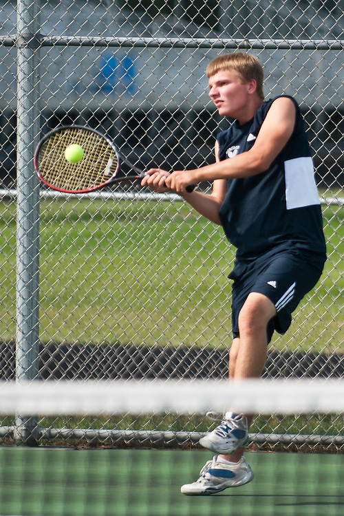 Lathan Goumas | The Bay City Times..Patrick Flynn, of the Heritage High School boys tennis team, hits the ball in a doubles match against Bay City Western High School tennis team members Jake Penkala and Diego Calvo at Heritage High School in Saginaw Township, MI., on Tuesday August 30, 2011.