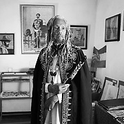 Portrait of Ras Hailu, Sheshamane.<br /> <br /> This portrait was taken in his banana leaf gallery and museum which contained many books, pictures and memorabilia about the history of Ethiopia and the legacy of His Imperial Majesty Haile Selassie.