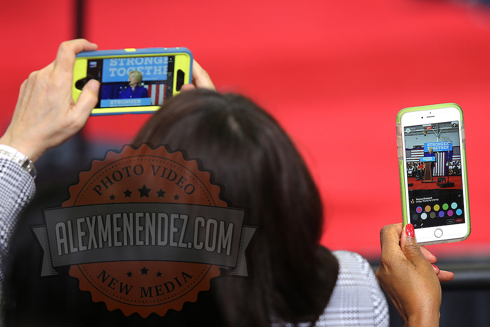 Supporters take photos of Democratic presidential candidate Hillary Clinton with their phones as she speaks during a campaign stop at the Frontline Outreach Center in Orlando, Fla., on Wednesday, Sept. 21, 2016. (Alex Menendez via AP)