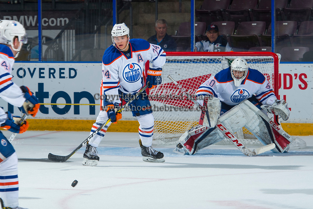 PENTICTON, CANADA - SEPTEMBER 9: Ethan Bear #74 of Edmonton Oilers watches the puck ahead of Stuart Skinner #50 of Edmonton Oilers against the Winnipeg Jets on September 9, 2017 at the South Okanagan Event Centre in Penticton, British Columbia, Canada.  (Photo by Marissa Baecker/Shoot the Breeze)  *** Local Caption ***