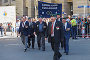 Old Soldiers and veterans from Commando squadron march during Brisbane ANZAC day 2013 parade