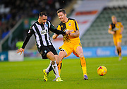 Plymouth Argyle's Peter Hartley and Cambridge Utd's Barry Corr during the Sky Bet League 2 match between Plymouth Argyle and Cambridge United at Home Park, Plymouth, England on 12 December 2015. Photo by Graham Hunt.