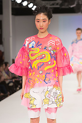 © Licensed to London News Pictures. 30/05/2015. London, UK. A model walks the runway during the Ravensbourne fashion show at Graduate Fashion Week 2015 wearing the collection of graduate student Kirsty Goodison. Graduate Fashion Week takes place from 30 May to 2 June 2015 at the Old Truman Brewery, Brick Lane. Photo credit : Bettina Strenske/LNP