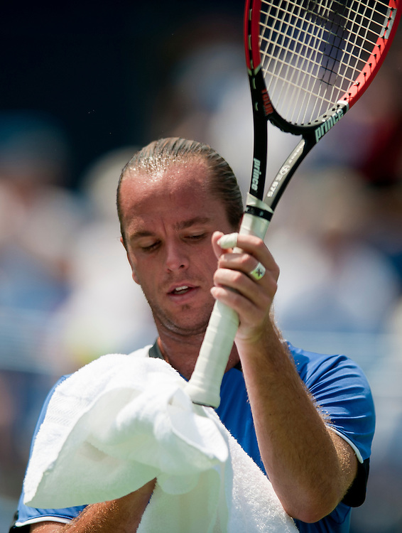 Aug 7, 2010 - Washington, District of Columbia, U.S., - XAVIER MALISSE dries his grip during a match against Marcos Baghdatis in the Legg Mason Tennis Classic semifinals in Washington on Saturday. The Eighth-seeded Baghdatis defeated the unseeded MALISSE 6-2, 7-6 (4) .(Credit Image: © Pete Marovich/ZUMA Press)