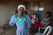 The family and grandmother of 14 year Sphiwe living in the Drakensburg Mountains in KwaZulu Natal.  December 2010