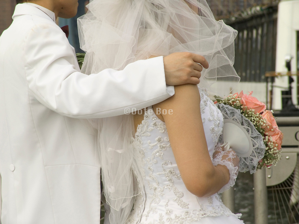 newly wed couple man having his arm on her shoulder