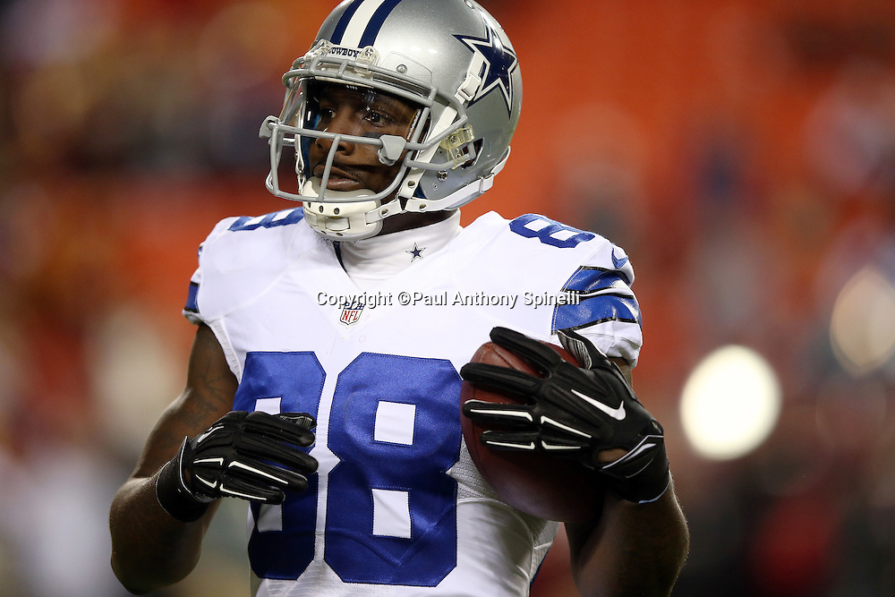 Dallas Cowboys wide receiver Dez Bryant (88) runs with the ball after catching a pass during pregame warmups before the 2015 week 13 regular season NFL football game against the Washington Redskins on Monday, Dec. 7, 2015 in Landover, Md. The Cowboys won the game 19-16. (©Paul Anthony Spinelli)
