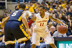 Feb 22, 2016; Morgantown, WV, USA; Iowa State Cyclones guard Monte Morris (11) dribbles while defended by West Virginia Mountaineers guard Jaysean Paige (5) during the first half at the WVU Coliseum. Mandatory Credit: Ben Queen-USA TODAY Sports