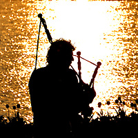 Bagpiper Silhouette at Sunset in Zurich, Switzerland<br />