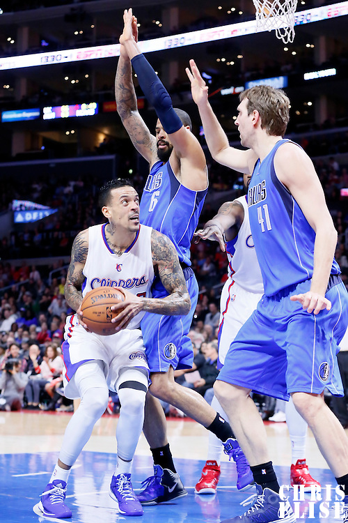 10 January 2014: Dallas Mavericks center Tyson Chandler (6) defends on Los Angeles Clippers forward Matt Barnes (22) during the Los Angeles Clippers 120-100 victory over the Dallas Mavericks, at the Staples Center, Los Angeles, California, USA.