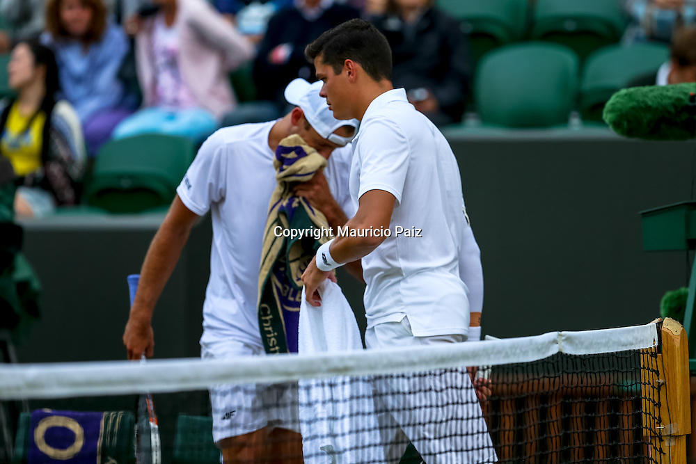 LONDON, ENGLAND - JUNE 28: Player of Country explain Gentlemen's Singles round match against player of country on day six of the Wimbledon Lawn Tennis Championships at the All England Lawn Tennis and Croquet Club at Wimbledon on June 28, 2014 in London, England.