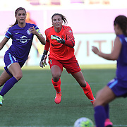Orlando Pride forward Alex Morgan (13) and Seattle Reign FC goalkeeper Hope Solo (1) watch the ball as Orlando Pride defender Samantha Witteman (26) charges the net during a NWSL soccer match at Camping World Stadium on May 8, 2016 in Orlando, Florida. (Alex Menendez via AP)